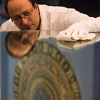 London July 23rd  A  conservator of the museum cleans  the six feet osse Mirir that was for 70 years the  world's largest telescope  . Photocall  at the Science Museum  for the unveiling of the Cosmos & Culture how Astronomy has shaped the world...***Standard Licence  Fee's Apply To All Image Use***.Marco Secchi /Xianpix. tel +44 (0) 845 050 6211. e-mail ms@msecchi.com or sales@xianpix.com.www.marcosecchi.com