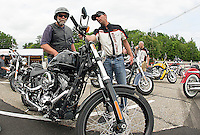 Harley Davidson Motor Company offering free demo rides at the Hart's Turkey Farm parking lot during Laconia's Motorcycle Week June 11, 2012