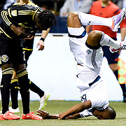 Kendall Waston, right, lands on his head during a 2-2 draw between the Vancouver Whitecaps and the Columbus Crew at BC Place in Vancouver, B.C., on April 8, 2015.