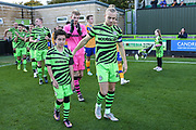 Forest Green Rovers Joseph Mills(23) with mascot during the EFL Sky Bet League 2 match between Forest Green Rovers and Mansfield Town at the New Lawn, Forest Green, United Kingdom on 19 October 2019.