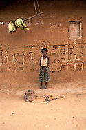 A girl in front of her house in a village near a logging town of Yokadouma, South East Cameroon. *** Local Caption *** Photography &amp; copyright<br /> <br /> Elma Okic<br /> +44 7763 196 706<br /> turtle_danger@hotmail.com<br /> <br /> Queens Quay 504<br /> 58 Upper Thames Street<br /> London<br /> EC4V 3EH