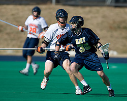 Navy midfielder Shane Durkin (35) and Virginia defenseman Mike Timms (44).  The Virginia Cavaliers scrimmaged the Navy Midshipmen in lacrosse at the University Hall Turf Field  in Charlottesville, VA on February 2, 2008.