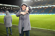Leeds United goalkeeper Illan Meslier (1), on loan from Leyton Orient, taken by Leeds United defender Ezgjan Alioski (10) pitch side during the EFL Sky Bet Championship match between Leeds United and Hull City at Elland Road, Leeds, England on 10 December 2019.