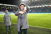 Leeds United goalkeeper Illan Meslier (1), on loan from Leyton Orient, taken by Leeds United defender Ezgjan Alioski (10) pitch side during the EFL Sky Bet Championship match between Leeds United and Hull City at Elland Road, Leeds, England on 10 December 2019.