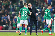 Northern Ireland manager Michael O'Neill shakes hands with Northern Ireland midfielder Gavin Whyte (18) following the UEFA European 2020 Qualifier match between Northern Ireland and Netherlands at National Football Stadium, Windsor Park, Northern Ireland on 16 November 2019.