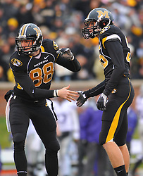 Nov 13, 2010; Columbia, MO, USA; Missouri Tigers kicker Grant Ressel (95) is congratulated by wide receiver Forrest Shock (88) after Ressel's point after in the first half at Memorial Stadium. Missouri won 38-28.  Mandatory Credit: Denny Medley-US PRESSWIRE