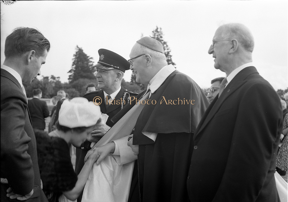 21/07/1962<br /> 07/21/ 1962<br /> 21 July 1962<br /> Cardinal Michael Browne's Garden Party at Aras an Uachtarain, Dublin. Guests at the President's Garden Party at Aras an Uachtarain are introduced to Cardinal Browne by His Excellency President Eamon de Valera.