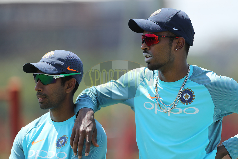 Wriddhiman Saha of India and Hardik Pandya of India  during the Indian team practice session and press conference held at the Supersport Park stadium in Centurion, Gauteng, South Africa ahead of the 2nd test match between South Africa and India on the 12th January 2018<br /> <br /> Photo by: Ron Gaunt / BCCI / SPORTZPICS