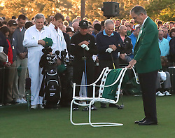 Augusta National Chairman Billy Payne leads a moment of silence for Arnold Palmer, his green jacket placed in his empty chair, before Gary Player and Jack Nicklaus tee off during the honorary start of the Masters at Augusta National Golf Club on Thursday, April 6, 2017, in Augusta, Ga. (Photo by Curtis Compton/Atlanta Journal-Constitution/TNS)  *** Please Use Credit from Credit Field ***
