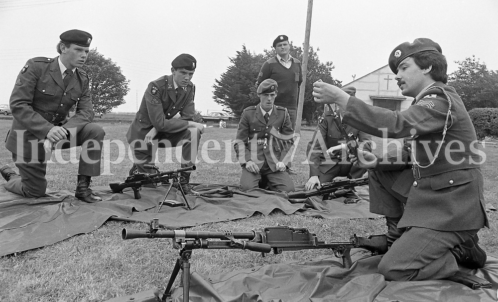Cpl Patrick Fox inspectng Pte Noel Dwyer(L), Pte Enda Allen and Pte Ray Murphy on the use of the Bren Gun at the 21st Batt Summer Camp at Gormanston Camp, Meath, 05/08/1982 (Part of the Independent Newspapers Ireland/NLI Collection).