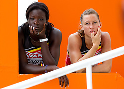 Anne Zagre and Eline Berings of Belgium after they competed during the first round of the women's 100m hurdles at the 2010 European Athletics Championships at the Olympic Stadium in Barcelona on July 30, 2010. (Photo by Vid Ponikvar / Sportida)