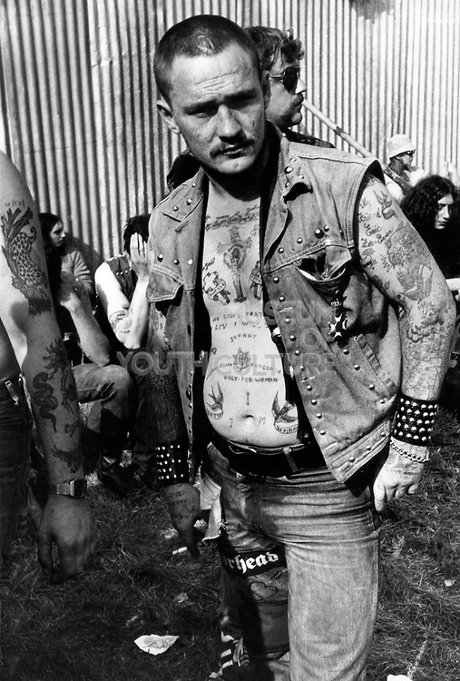 Biker, Hell's Angel covered in Tattoo's, Reading Festival, UK, 1980's