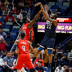 Nov 29, 2017; New Orleans, LA, USA; Minnesota Timberwolves forward Andrew Wiggins (22) shoots over New Orleans Pelicans guard Jrue Holiday (11) during the second half at the Smoothie King Center. The Timberwolves defeated the Pelicans 120-102. Mandatory Credit: Derick E. Hingle-USA TODAY Sports