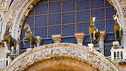 Bronze horses above the entrance to Basilica San Marco (Saint Mark's Cathedral), Venice, Veneto, Italy