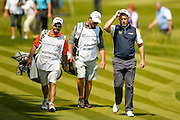 English golf professional Lee Westwood  tips his cap to the gallery as he walks onto the 18th green at the BMW PGA Championship at the Wentworth Club, Virginia Water, United Kingdom on 27 May 2016. Photo by Simon Davies.