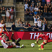 Philadelphia Union Attacker C.J. SAPONG (17) takes a shot as New York Red Bulls Keeper LUIS ROBLES (31) makes the save in the second half of a Major League Soccer match between the Philadelphia Union and New York Red Bulls Sunday, July. 17, 2016 at Talen Energy Stadium in Chester, PA.