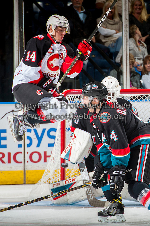 KELOWNA, CANADA - SEPTEMBER 28: Colby McAuley #14 of Prince George Cougars jumps to clear a shot on net of Michael Herringer #30 of Kelowna Rockets on September 28, 2016 at Prospera Place in Kelowna, British Columbia, Canada.  (Photo by Marissa Baecker/Shoot the Breeze)  *** Local Caption *** Michael Herringer; Colby McAuley;