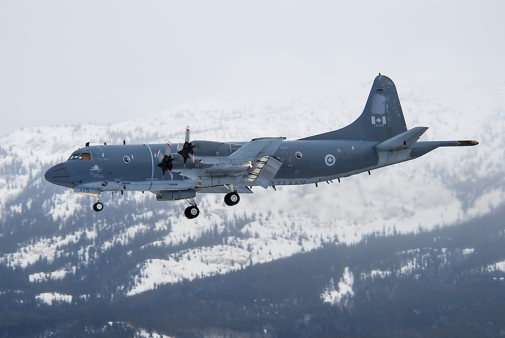 CP-140 Aurora on a snowy approach into Whitehorse International Airport