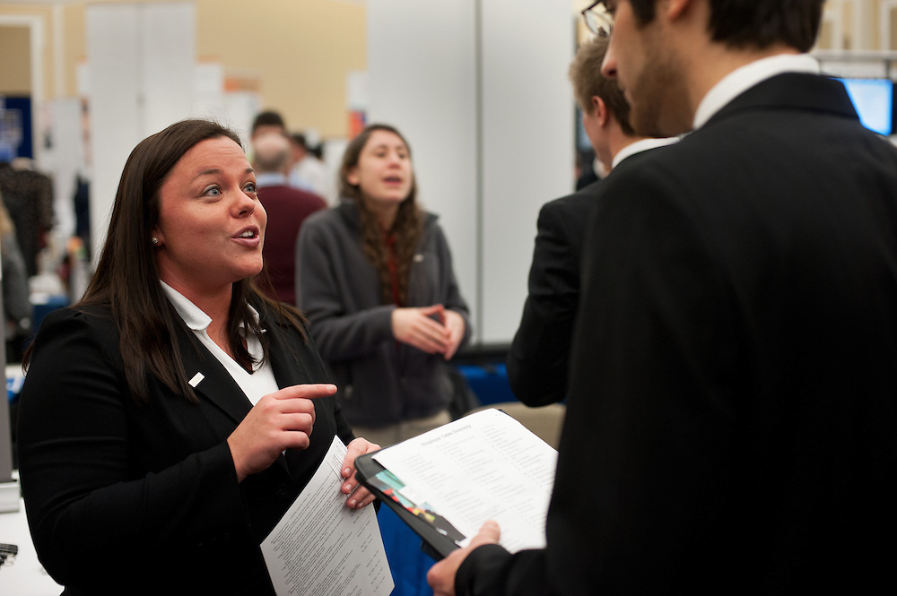 Laura Luckhaupt (left) and Samantha Santos (center) talk to students about opportunities at their respective companies during the Spring Career and Internship Fair. Photo by: Ross Brinkerhoff.