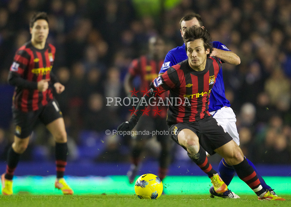 LIVERPOOL, ENGLAND - Tuesday, January 31, 2012: Manchester City's David Silva in action against Everton's Darron Gibson during the Premiership match at Goodison Park. (Pic by Vegard Grott/Propaganda)