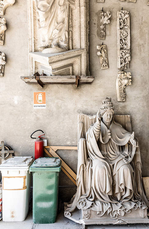 Milan, La Veneranda Fabbrica del Duomo. this is the place where deteriored parts of the Milan Duomo are stocked and remade as new by local artisan. Chalk models