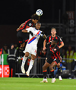 Nathan Ake (5) of AFC Bournemouth clashes heads with Jordan Ayew (14) of Crystal Palace which leaves Ake with a nose bleed during the Premier League match between Bournemouth and Crystal Palace at the Vitality Stadium, Bournemouth, England on 1 October 2018.