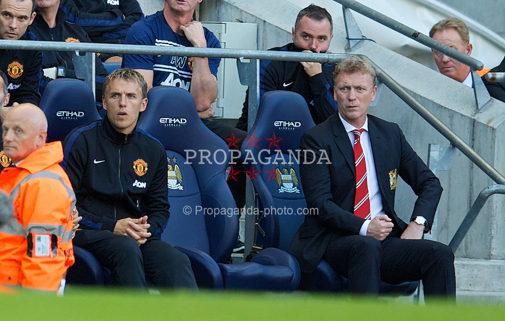 MANCHESTER, ENGLAND - Sunday, September 22, 2013: Manchester United's David Moyes looks on dejected as his side are thrashed 4-1 by Manchester City during the Premiership match at the City of Manchester Stadium. (Pic by David Rawcliffe/Propaganda)