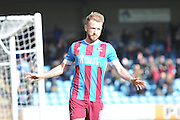 Paddy Madden of Scunthorpe United celebrtates scoring goal for Scunthorpe to go 5-0 up  during the Sky Bet League 1 match between Scunthorpe United and Swindon Town at Glanford Park, Scunthorpe, England on 28 March 2016. Photo by Ian Lyall.