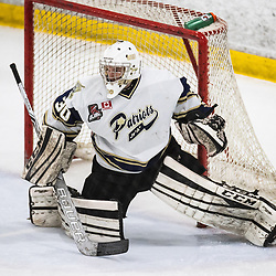 TORONTO, ON - APR 10, 2018: Ontario Junior Hockey League, South West Conference Championship Series. Game seven of the best of seven series between the Georgetown Raiders and the Toronto Patriots, Tyler Fassel #30 of the Toronto Patriots follows the play during the first period.<br /> (Photo by Kevin Raposo / OJHL Images)