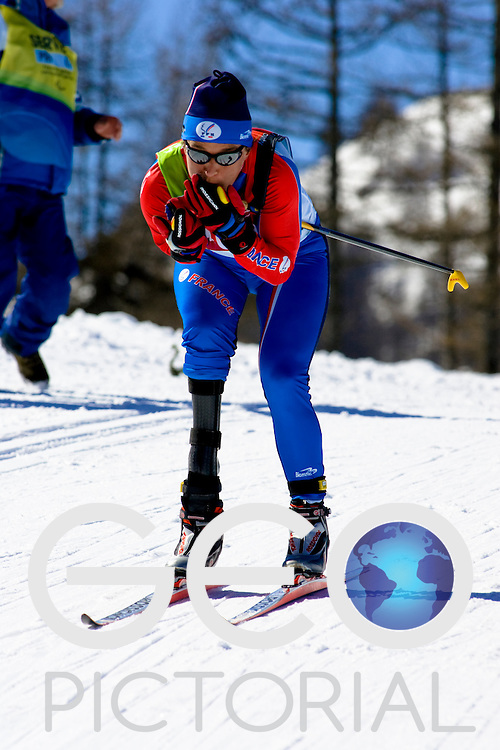 PRAGELATO PLAN, ITALY - MARCH 12: Anne Floriet of France competes in the Womens Cross Country Skiing 5km Standing on Day 2 of the 2006 Turin Winter Paralympic Games on March 12, 2006 in Pragelato Plan, Italy.