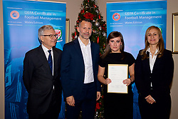 NEWPORT, WALES - Wednesday, December 12, 2018: Agata Koziel receives her certificate from Wales national team manager Ryan Giggs alongside Jean-Loup Chappelet, UEFA CFM Dean (L) and Valentina Mercolli, UEFA HatTrick Programme Manager (R) during the UEFA Certificate of Football Management Graduation Ceremony in the 2010 Clubhouse at the Celtic Manor Resort. (Pic by David Rawcliffe/Propaganda)