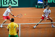 (L) Marcin Matkowski & (R) Mariusz Fyrstenberg both from Poland in ation while men's double during the BNP Paribas Davis Cup 2013 between Poland and Australia at Torwar Hall in Warsaw on September 14, 2013.<br /> <br /> Poland, Warsaw, September 14, 2013<br /> <br /> Picture also available in RAW (NEF) or TIFF format on special request.<br /> <br /> For editorial use only. Any commercial or promotional use requires permission.<br /> <br /> Photo by © Adam Nurkiewicz / Mediasport