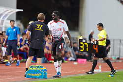 BANGKOK, THAILAND - Sunday, July 28, 2013: Liverpool's Kolo Toure and manager Brendan Rodgers during a preseason friendly match against Thailand XI at the Rajamangala National Stadium. (Pic by David Rawcliffe/Propaganda)