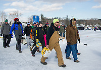 Pond Hockey enthusiasts converge on Meredith Bay with plenty of provisions Saturday afternoon.  (Karen Bobotas/for the Laconia Daily Sun)