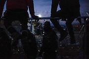 02 December 2015, Greece, Idomeni - Migrants and refugees wait to cross the Greek-Macedonian border near the village of Idomeni, Greece.