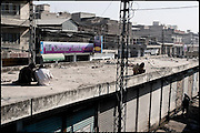 "Heroin abusers consume their dose away from eyes of the local people on a roof top of a building. Rawalpindi, Pakistan, on friday, November 28 2008.....""Pakistan is one of the countries hardest hits by the narcotics abuse into the world, during the last years it is facing a dramatic crisis as it regards the heroin consumption. The Unodc (United Nations Office on Drugs and Crime) has reported a conspicuous decline in heroin production in Southeast Asia, while damage to a big expansion in Southwest Asia. Pakistan falls under the Golden Crescent, which is one of the two major illicit opium producing centres in Asia, situated in the mountain area at the borderline between Iran, Afghanistan and Pakistan itself. .During the last 20 years drug trafficking is flourishing in the Country. It is the key transit point for Afghan drugs, including heroin, opium, morphine, and hashish, bound for Western countries, the Arab states of the Persian Gulf and Africa..Hashish and heroin seem to be the preferred drugs prevalence among males in the age bracket of 15-45 years, women comprise only 3%. More then 5% of whole country's population (constituted by around 170 milion individuals),  are regular heroin users, this abuse is conspicuous as more of an urban phenomenon. The substance is usually smoked or the smoke is inhaled, while small number of injection cases have begun to emerge in some few areas..Statistics say, drug addicts have six years of education. Heroin has been identified as the drug predominantly responsible for creating unrest in the society."""