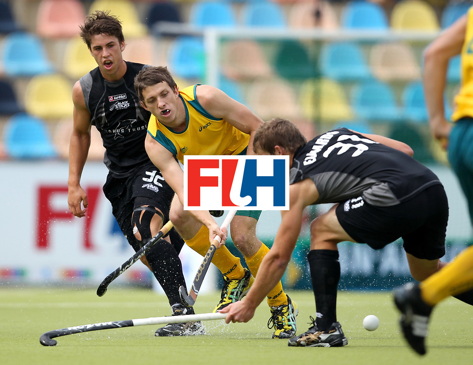 Mens Champions Trophy, Monchengladbach, Germany, 2010<br /> Australia v New Zealand  on Day 1<br /> Australia's Simon Orchard pushes forward against New Zealand Steven Edawards<br /> Credit: Grant Treeby<br /> <br /> Editorial use only (No Archiving) Unless previously arranged
