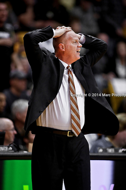 SHOT 2/19/14 10:18:17 PM - Colorado head basketball coach Tad Boyle reacts to a call by the referees during a game against Arizona State in their regular season Pac-12 basketball game at the Coors Events Center in Boulder, Co. Colorado won the game 61-52.<br /> (Photo by Marc Piscotty / &copy; 2014)