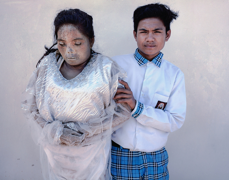 Nofial (19) with his mother, Sarce Limbong, who died in 2015 at age 43.<br /> <br /> Ma'nene is a tradition that takes place in August after harvest where the bodies of the dead loved ones are exhumed to be cleaned, groomed and dressed. For most, it's a bittersweet moment, a chance to reunite and physically see and touch and reconnect with loved ones who had passed on.