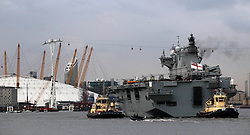 © Licensed to London News Pictures. 13/07/2012, London, UK.  Helicopters carrier, HMS Ocean sails up the river Thames to Greenwich in London to provide security for the upcoming London 2012 Olympic Games, Friday, July 13, 2012. Photo credit : Sang Tan/LNP