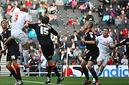 Picture by David Horn/Focus Images Ltd +44 7545 970036.29/09/2012.Dean Lewington, Captain of Milton Keynes Dons with an attacking header  during the npower League 1 match at stadium:mk, Milton Keynes.
