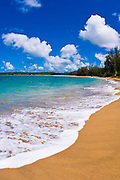 Empty beach and blue waters on Hanalei Bay, Island of Kauai, Hawaii
