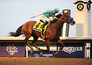 Victor Espinoza rides American Pharoah to win the Breeders' Cup Classic at Keeneland Racecourse on Saturday, Oct. 31, 2015 in Lexington, KY.  Longines, the Swiss watch manufacturer known for its elegant timepieces, is the Official Watch and Timekeeper of the Breeders' Cup World Championships and the Triple Crown. (Photo by Diane Bondareff/Invsion for Longines/AP Images)