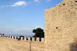 Castiglione del Lago:  A lone visitor walks the ramparts of Castellon del Leone (Lion Castle), a medieval fortress that dominates Lake Trasimeno.