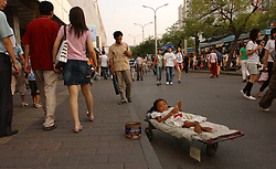 BEIJING, CHINA - JUNE-4-2005 - China - Chinese - poverty - population - shopping - economy  -  consumer - Beijing - China (PHOTO © JOCK FISTICK)