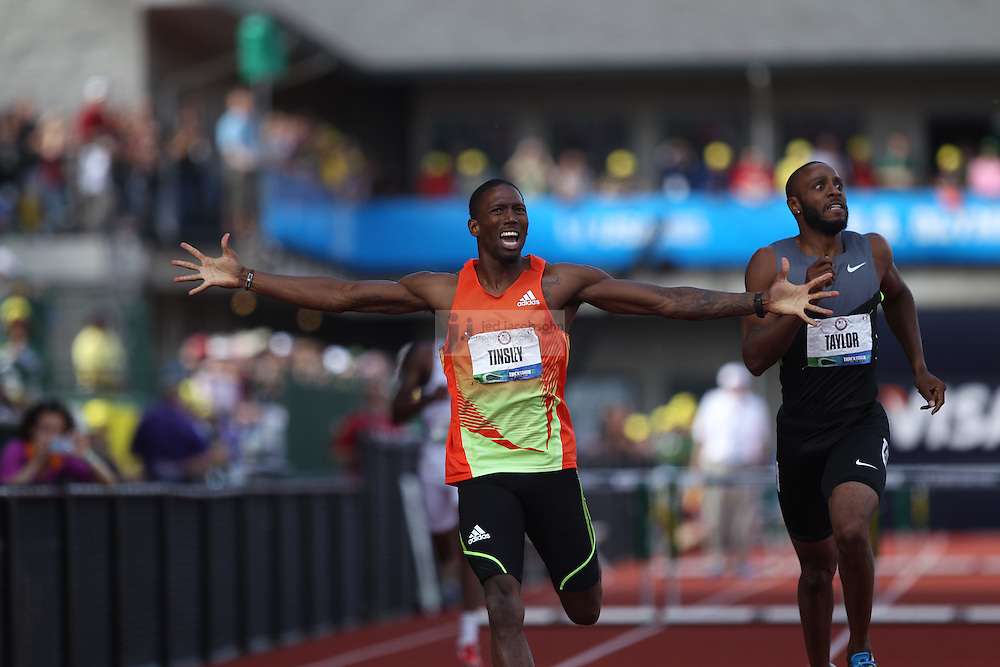 Michael Tinsley  celebrates after winning the finals of the 400m hurdles as Angelo Taylor looks on during day 10 of the U.S. Olympic Trials for Track & Field at Hayward Field in Eugene, Oregon, USA 1 Jul 2012..(Jed Jacobsohn/for The New York Times)....