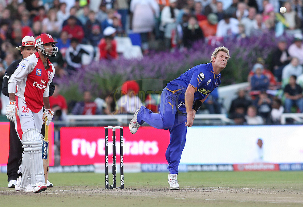 CAPE TOWN, SOUTH AFRICA - 26 April 2009. Shane Warne gives the ball some flight  during the IPL Season 2 match between TheKings X1 Punjab and Rajasthan Royals held at Sahara Park Newlands in Cape Town, South Africa..