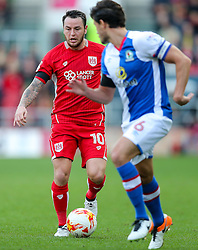 Lee Tomlin of Bristol City is challenged by Jason Lowe of Blackburn Rovers  - Rogan Thomson/JMP - 22/10/2016 - FOOTBALL - Ashton Gate Stadium - Bristol, England - Bristol City v Blackburn Rovers - Sky Bet EFL Championship.