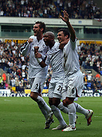 Photo: Paul Thomas.<br /> Bolton Wanderers v Liverpool. The Barclays Premiership. 30/09/2006.<br /> <br /> Bolton players Nicky Hunt (L) and El Hadji Diouf (C) celebrate Gary Speed's goal (6).