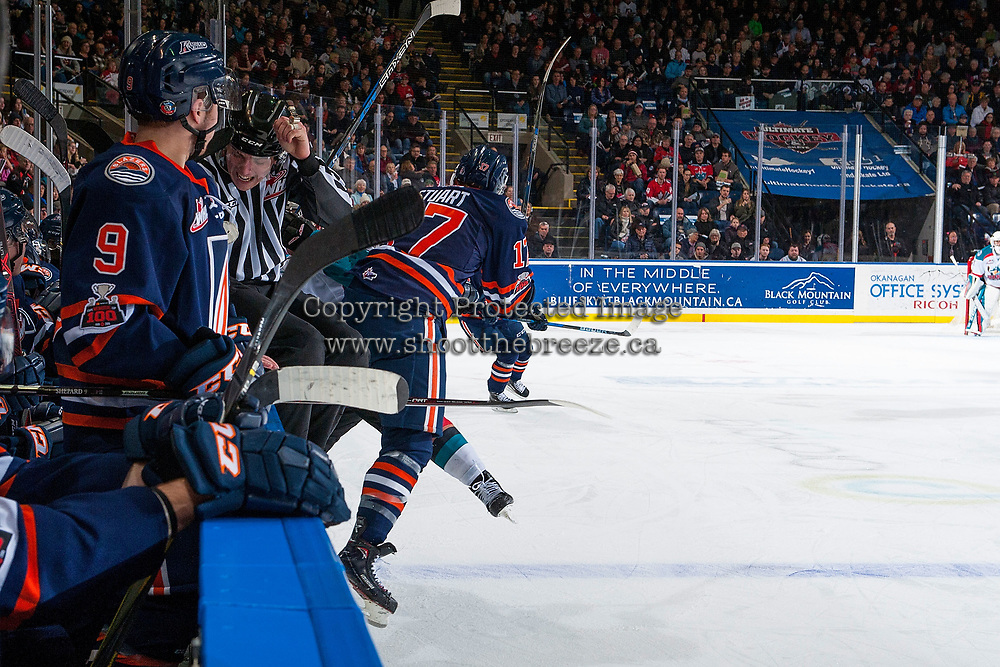 KELOWNA, CANADA - DECEMBER 27: WHL linesman, Tim Plamondon, jumps on the boards as Brodi Stuart #17 of the Kamloops Blazers is checked by a player of the Kelowna Rockets on December 27, 2017 at Prospera Place in Kelowna, British Columbia, Canada.  (Photo by Marissa Baecker/Shoot the Breeze)  *** Local Caption ***